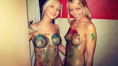 These two playful little blondies enjoy body painting as much as they did when they were little girls. It's just that their newly developed titties add quite an erotic touch to the game. And if they knew the scene had been recorded, I bet they'd be excited even more.
